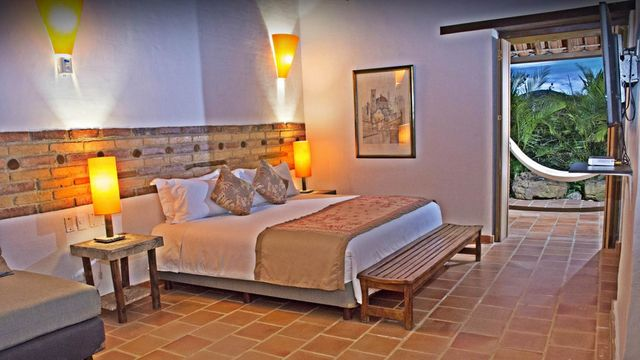 Rondreis Colombia Santander Barichara Terre Barichara slaapkamer met 2-persoonsbed