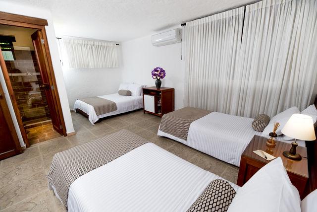 Rondreis Colombia Antioquia Medellin La Campana boutique 3-persoons slaapkamer