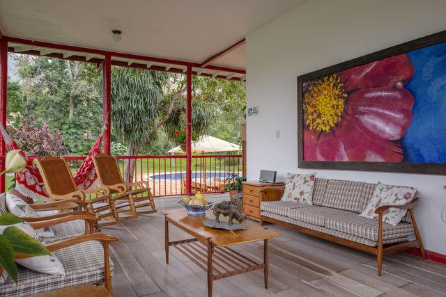 Rondreis Colombia Quindio Manizales Hacienda Venecia veranda koffielodge