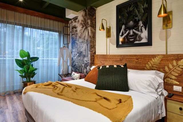 Rondreis Colombia Antioquia Medellin Casa Celestino boutique sfeervol ingerichte slaapkamer